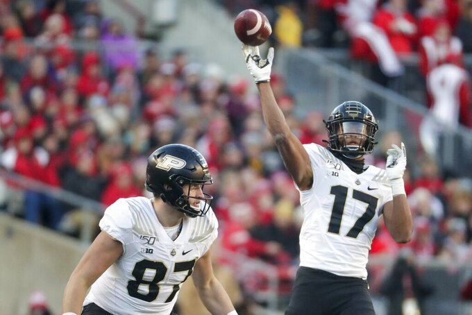 Purdue's Byron Perkins throws during the first half of an NCAA college football game against Wisconsin Saturday, Nov. 23, 2019, in Madison, Wis. (AP Photo/Morry Gash)