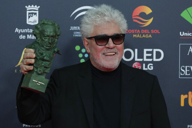 Spanish film director Pedro Almodovar poses with his trophy after winning the best film award for