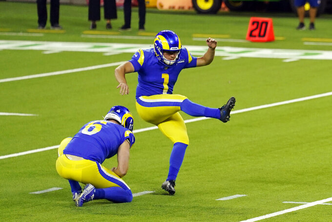 FILE - In this Monday, Oct. 26, 2020, file photo, Los Angeles Rams kicker Samuel Sloman (1) makes a field goal against the Chicago Bears during the first half of an NFL football game in Inglewood, Calif. The Rams have released rookie kicker Samuel Sloman after seven games with the team. The Rams (5-2) dropped their seventh-round pick on Tuesday, after he had a field goal attempt blocked in their 24-10 win over Chicago on Monday night.(AP Photo/Ashley Landis, File)