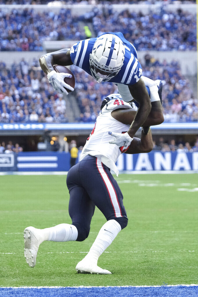 Indianapolis Colts wide receiver Zach Pascal (14) dives over Houston Texans inside linebacker Zach Cunningham (41) for a touchdown during the first half of an NFL football game, Sunday, Oct. 20, 2019, in Indianapolis. (AP Photo/AJ Mast)