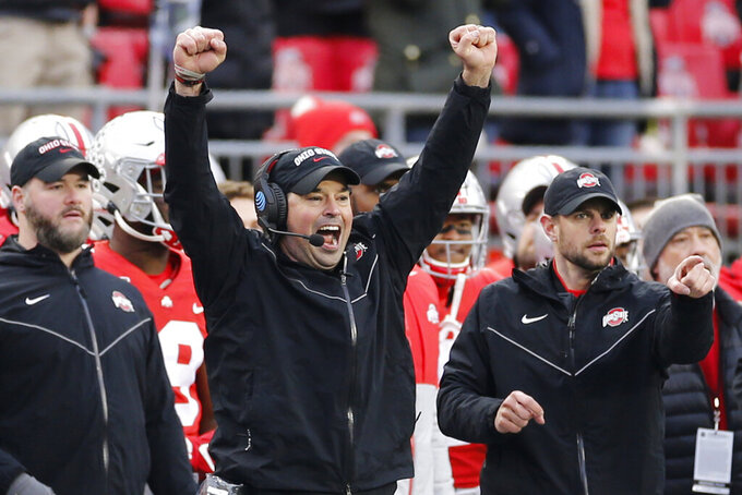 FILE - In this Nov. 23, 2019, file photo, Ohio State head coach Ryan Day celebrates on the sideline against Penn State during an NCAA college football game, in Columbus, Ohio. Heading into this year's slate of conference title games a case could be made that No. 1 LSU (No. 2 CFP), No. 2 Ohio State (No. 1 CFP) and No. 3 Clemson (No. 3 CFP) have all done enough already to lose their conference championship games and still get in the College Football Playoff.(AP Photo/Jay LaPrete, File)