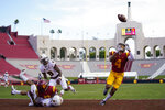Southern California wide receiver Bru McCoy (4) catches a deflected pass in the end zone for a touchdown against Arizona State during the second half of an NCAA college football game Saturday, Nov. 7, 2020, in Los Angeles. AP Photo/Ashley Landis)