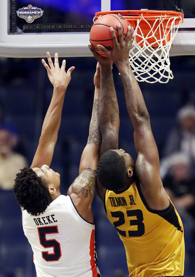 Auburn forward Chuma Okeke (5) and Missouri forward Jeremiah Tilmon (23) reach for a rebound in the second half of an NCAA college basketball game at the Southeastern Conference tournament Thursday, March 14, 2019, in Nashville, Tenn. (AP Photo/Mark Humphrey)