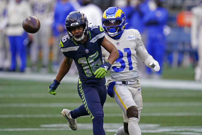 Seattle Seahawks wide receiver Tyler Lockett (16) and Los Angeles Rams cornerback Darious Williams (31) watch an incomplete pass during the first half of an NFL football game, Sunday, Dec. 27, 2020, in Seattle. (AP Photo/Elaine Thompson)