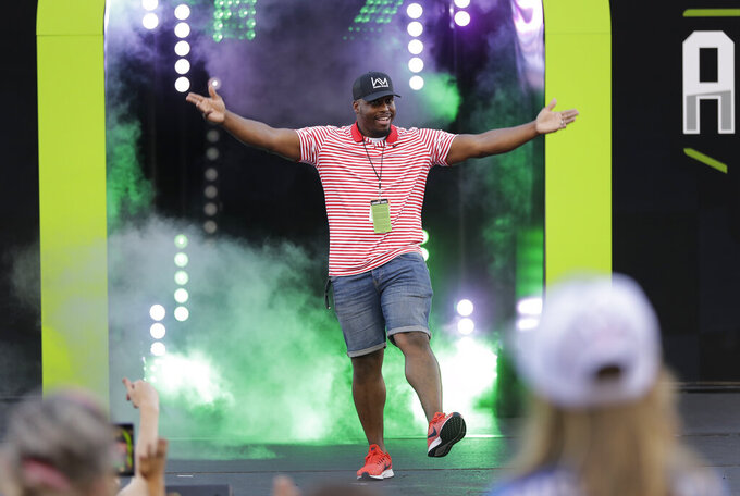Former Carolina Panthers running back Jonathan Stewart is introduced before the NASCAR All-Star Race at Charlotte Motor Speedway in Concord, N.C., Saturday, May 18, 2019. (AP Photo/Chuck Burton)