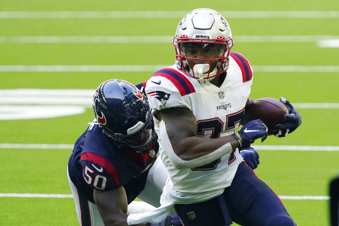 New England Patriots running back Damien Harris (37) runs past Houston Texans linebacker Tyrell Adams (50) during the first half of an NFL football game, Sunday, Nov. 22, 2020, in Houston. (AP Photo/David J. Phillip)