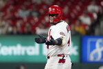St. Louis Cardinals' Yadier Molina celebrates after hitting a double during the fourth inning of a baseball game against the Los Angeles Dodgers Wednesday, Sept. 8, 2021, in St. Louis. (AP Photo/Jeff Roberson)