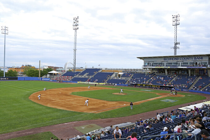 """FILE - This Sunday, June 28, 2015, file photo shows an overall view of the Staten Island Yankees in action against the State College Spikes at Richmond County Bank Ballpark during a minor league baseball game in Staten Island, N.Y. The owners of the Staten Island Yankees announced in a statement Thursday, Dec. 3, 2020, that with """"great regret, we must cease operations."""" They also said they were suing the New York Yankees and Major League Baseball """"to hold those entities accountable for false promises"""" that they would always keep the team as a farm club. (AP Photo/Gregory Payan, File)"""