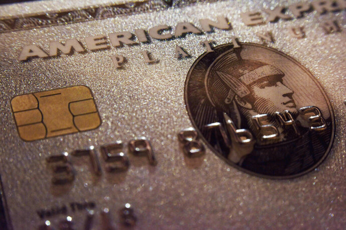 FILE - This Oct. 4, 2016, file photo shows a mockup of an American Express Platinum Card provided by the company, in New York. American Express reports earnings Friday, July 19, 2019. (AP Photo/Patrick Sison, File)