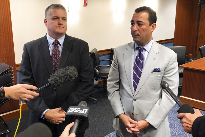 Shane Sidebottom, left, and Hans Poppe speak with reporters in Frankfort, Ky., on Wednesday, Nov. 7, 2018. Sidebottom and Poppe represent two state employees who say they were retaliated against for reporting sexual harassment allegations against state Republican lawmakers. A judge is weighing whether to redact portions of deposition testimony from a woman who made the allegations.  (AP Photo/Adam Beam)