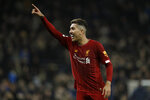 Liverpool's Roberto Firmino celebrates at the end of the English Premier League soccer match between Tottenham Hotspur and Liverpool at the Tottenham Hotspur Stadium in London, England, Saturday, Jan. 11, 2020. Liverpool won 1-0. (AP Photo/Matt Dunham)