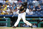 Pittsburgh Pirates' Josh Bell drives in two runs with a double off Chicago White Sox starting pitcher Reynaldo Lopez during the first inning of a baseball game in Pittsburgh, Tuesday, May 15, 2018. (AP Photo/Gene J. Puskar)