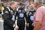 Bill Elliott, Chase Elliott and Tony Kanaan, from left, talk with Darrell Waltrip, right, before an SRX Series auto race Saturday, July 17, 2021, in Nashville, Tenn. (AP Photo/Mark Humphrey)