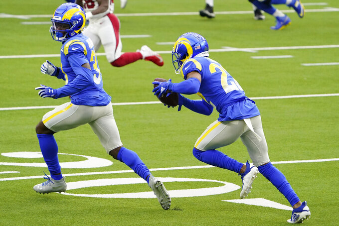Los Angeles Rams cornerback Troy Hill, right, returns an interception for a touchdown against the Arizona Cardinals during the first half of an NFL football game in Inglewood, Calif., Sunday, Jan. 3, 2021. (AP Photo/Jae C. Hong)