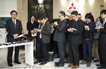Mitsubishi Motors CEO Osamu Masuko, left, listens to reporters' questions during a press conference at its headquarters in Tokyo Friday, Jan. 18, 2019. Masuko said the Japanese automaker's board met and discussed new allegations of wrongdoing by its former chairman, Carlos Ghosn. (AP Photo/Eugene Hoshiko)