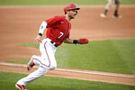 Washington Nationals' Trea Turner runs toward home to score on a single by Josh Harrison during the first inning of the team's baseball game against the San Diego Padres, Saturday, July 17, 2021, in Washington. (AP Photo/Nick Wass)