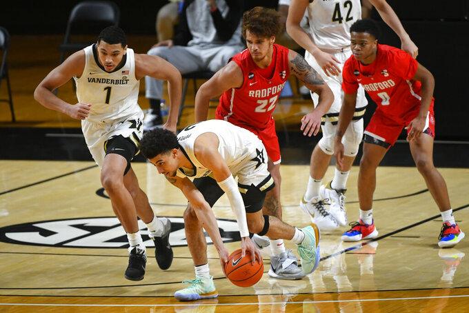 Vanderbilt guard Scotty Pippen Jr. grabs a steal from Radford center Lewis Djonkam (22) during the first half of an NCAA college basketball game Saturday, Dec. 19, 2020, in Nashville, Tenn. (AP Photo/John Amis)