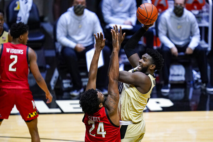 Purdue forward Trevion Williams (50) shoots over Maryland forward Donta Scott (24) during the second half of an NCAA college basketball game in West Lafayette, Ind., Friday, Dec. 25, 2020. (AP Photo/Michael Conroy)