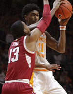 Arkansas guard Mason Jones (13) defends Tennessee forward Kyle Alexander (11) in the first half of an NCAA college basketball game, Tuesday, Jan. 15, 2019, in Knoxville, Tenn. (AP Photo/Shawn Millsaps)