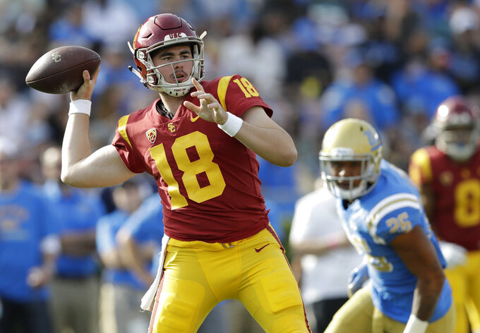 No. 3 Notre Dame visits rival USC at brink of playoff berth