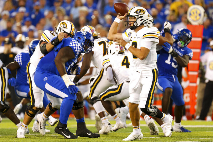 Missouri quarterback Connor Bazelak (8) throws a pass during the first half of an NCAA college football game against Kentucky in Lexington, Ky., Saturday, Sept. 11, 2021. (AP Photo/Michael Clubb)