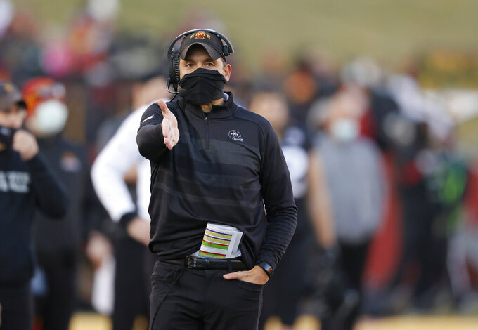 Iowa State head coach Matt Campbell gestures to an official after a call along the sideline during the first half of an NCAA college football game against West Virginia, Saturday, Dec. 5, 2020, in Ames, Iowa. (AP Photo/Matthew Putney)