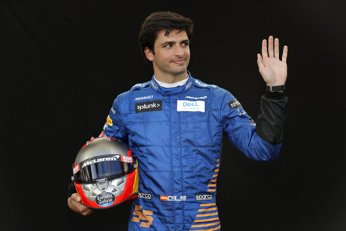 McLaren driver Carlos Sainz of Spain waves as he poses for a photo at the Australian Formula One Grand Prix in Melbourne, Thursday, March 12, 2020. (AP Photo/Rick Rycroft)