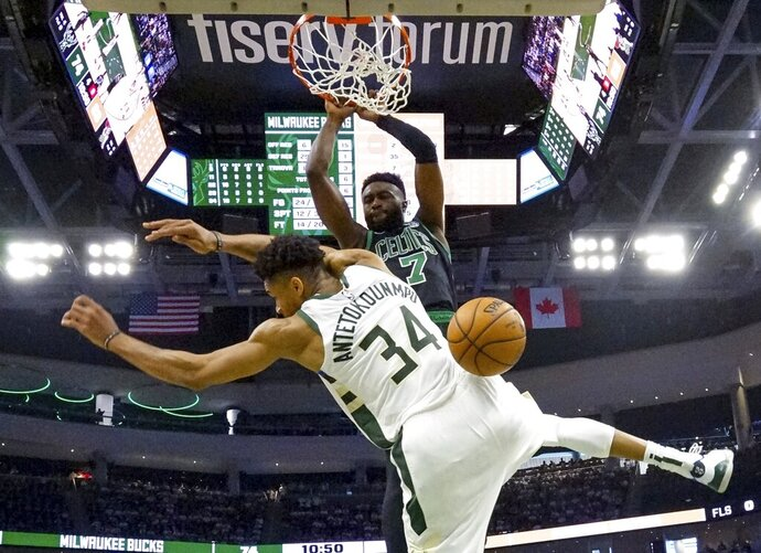 Boston Celtics' Jaylen Brown dunks over Milwaukee Bucks' Giannis Antetokounmpo during the second half of Game 1 of a second round NBA basketball playoff series Sunday, April 28, 2019, in Milwaukee. The Celtics won 112-90 to take a 1-0 lead in the series. (AP Photo/Morry Gash)