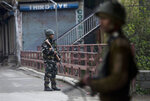Indian paramilitary soldiers stand guard on a deserted street during the second phase of India's general elections, in Srinagar, Indian controlled Kashmir, Thursday, April 18, 2019. Kashmiri separatist leaders who challenge India's sovereignty over the disputed region have called for a boycott of the vote. Most polling stations in Srinagar and Budgam areas of Kashmir looked deserted in the morning with more armed police, paramilitary soldiers and election staff present than voters. (AP Photo/ Dar Yasin)
