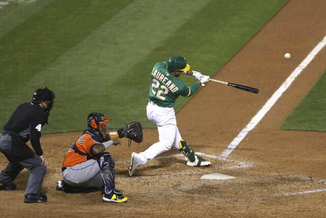 Oakland Athletics's Ramón Laureano drives in the winning run with a single against the Houston Astros during the ninth inning of a baseball game in Oakland, Calif., Wednesday, Sept. 9, 2020. (AP Photo/Jed Jacobsohn)
