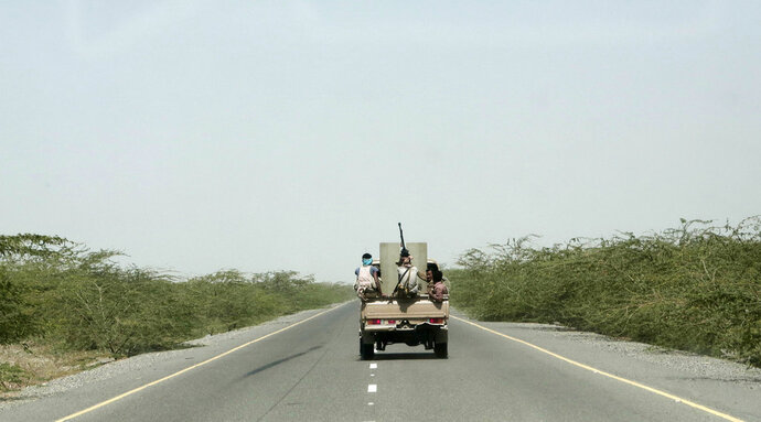 FILE - In this Feb. 12, 2018 file photo, Saudi-backed forces, part of Ahmed al-Kawkabani's, southern resistance unit in Hodeida, ride in their vehicle, in Hodeida, Yemen. The Saudi-led coalition backing Yemen's exiled government began an assault Wednesday, June 13, 2018 on the port city of Hodeida, the main entry point for food in a country already teetering on the brink of famine.(AP Photo/Nariman El-Mofty, File)