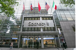 Flags fly on the front of Sotheby's auction house, in New York, Monday, June 17, 2019. BidFair USA is taking auction house Sotheby's private in a deal valued at $3.7 billion. (AP Photo/Richard Drew)