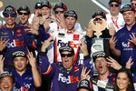 Denny Hamlin, center, and his race team celebrate in Victory Lane after his win in the NASCAR Cup Series auto race Raceway, Sunday, Nov. 10, 2019, in Avondale, Ariz. (AP Photo/Ralph Freso)