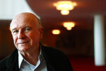 FILE - In this April 1, 1010, file photo, playwright Terrence McNally poses at the Kennedy Center in Washington. McNally, one of America's great playwrights whose prolific career included winning Tony Awards for the plays