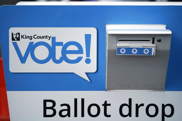 A ballot drop box stands outside the King County Elections office Tuesday, Oct. 13, 2020, in Tukwila, Wash. Ballots for county residents are being mailed Wednesday. Washington state is one of five states, along with Colorado, Hawaii, Oregon, and Utah, that conduct elections entirely by mail-in voting. (AP Photo/Elaine Thompson)