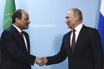 Russian President Vladimir Putin, right, and Egypt's President Abdel Fattah el-Sisi shake hands during their meeting in the Black Sea resort of Sochi, Russia, Wednesday, Oct. 23, 2019. (TASS News Agency Pool Photo via AP)