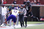 Cincinnati running back Charles McClelland (10) makes East Carolina linebacker Aaron Ramseur (51) miss in the first quarter of an NCAA college football game, Friday, Nov. 23, 2018, in Cincinnati. (Kareem Elgazzar/The Cincinnati Enquirer via AP)