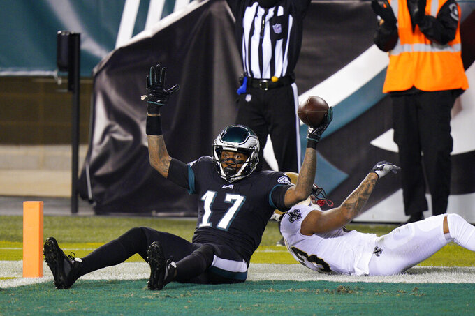Philadelphia Eagles' Alshon Jeffery reacts after scoring a touchdown against New Orleans Saints' Marshon Lattimore during the first half of an NFL football game, Sunday, Dec. 13, 2020, in Philadelphia. (AP Photo/Chris Szagola)