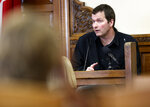 Todd Mullis, 43, takes the stand during his trial, Thursday, Sept. 19, 2019 at Dubuque County Courthouse in Dubuque, Iowa. Mullis, charged with first-degree murder in the slaying of 39-year-old Amy Mullis on Nov. 10 at the farm about 4 miles northwest of Earlville, Iowa. (Dave Kettering/Telegraph Herald via AP)