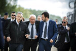 In this handout photo provided by the Hungarian Prime Minister's Press Office shows Hungarian Prime Minister Viktor Orban, left, and Italian Interior Minister Matteo Salvini, right, during their visit at the Hungarian-Serbian border near Roszke, 180 kms southeast of Budapest, Hungary, Thursday, May 2, 2019. (Balazs Szecsodi/Hungarian Prime Minister's Press Office/MTI via AP)