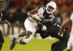 West Virginia wide receiver Gary Jennings Jr. (12) is tackled by Iowa State defensive back D'Andre Payne (1) after making a reception during the second half of an NCAA college football game, Saturday, Oct. 13, 2018, in Ames, Iowa. (AP Photo/Charlie Neibergall)