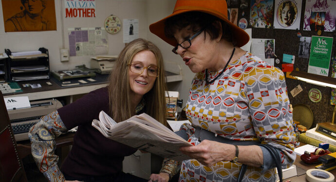 This image released by LD Entertainment and Roadside Attractions shows Julianne Moore as Gloria Steinem, left, and Bette Midler as Bella Abzug in a scene from