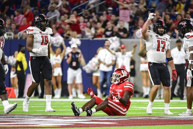 Houston wide receiver KeSean Carter (20) reacts to an incomplete pass against Texas Tech during the second half of an NCAA college football game Saturday, Sept. 4, 2021, in Houston. (AP Photo/Justin Rex)
