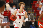 Texas Tech's Mac McClung (0) dribbles the ball down the court during the first half of an NCAA college basketball game against Sam Houston State, Friday, Nov. 27, 2020, in Lubbock, Texas. (AP Photo/Brad Tollefson)