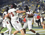 Louisville tight end Marshon Ford (83) celebrates with teammates after he scored a touchdown against Georgia Tech during the first half of an NCAA college football game Friday, Oct. 9, 2020, in Atlanta. (Hyosub Shin/Atlanta Journal-Constitution via AP)