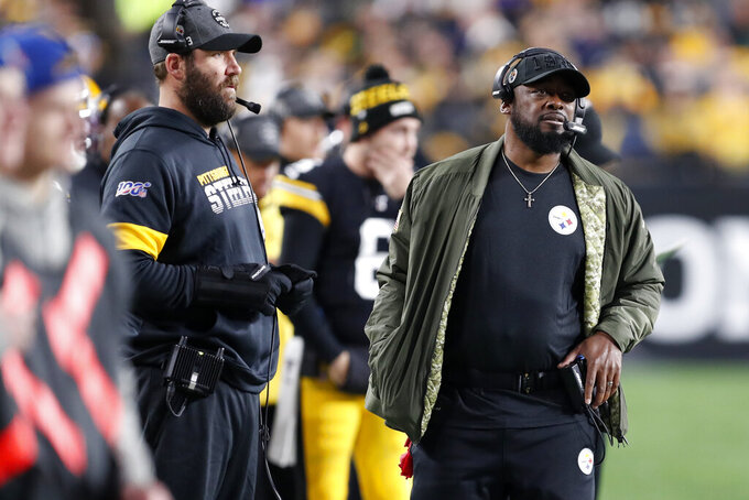 Pittsburgh Steelers head coach Mike Tomlin, right, and quarterback Ben Roethlisberger stand on the sideline during the first half of an NFL football game against the Los Angeles Rams in Pittsburgh, Sunday, Nov. 10, 2019. (AP Photo/Keith Srakocic)