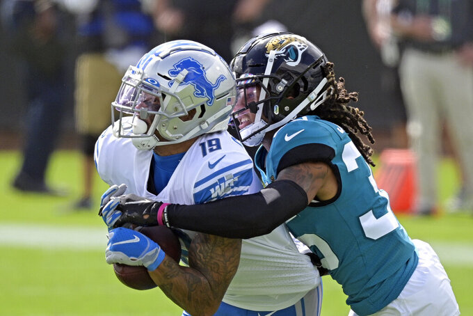 Detroit Lions wide receiver Kenny Golladay, left, makes a reception against Jacksonville Jaguars cornerback Sidney Jones during the first half of an NFL football game, Sunday, Oct. 18, 2020, in Jacksonville, Fla. (AP Photo/Phelan M. Ebenhack)