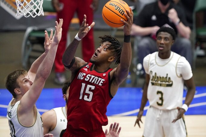 Colorado State forward James Moors (10), left, defends against a shot-attempt by North Carolina State forward Manny Bates (15) in the second half of an NCAA college basketball game in the quarterfinals of the NIT, Thursday, March 25, 2021, in Frisco, Texas. (AP Photo/Tony Gutierrez)