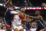 Southern California's Kevin Porter Jr., center, is defended by Arizona's Brandon Williams, left, and Justin Coleman during the first half of an NCAA college basketball game Thursday, Jan. 24, 2019, in Los Angeles. (AP Photo/Jae C. Hong)