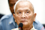 FILE - In this March, 20, 2008 file photo, former Khmer Rouge's chief ideologist and No. 2 leader, Nuon Chea, foreground, sits in the court hall before the final statements at the U.N.-backed war crimes tribunal in Phnom Penh, Cambodia. Chea, the chief ideologue of the communist Khmer Rouge regime that destroyed a generation of Cambodians, died Sunday, Aug. 4, 2019,  the country's U.N.-assisted genocide tribunal announced. He was 93. (AP Photo/Heng Sinith, File)
